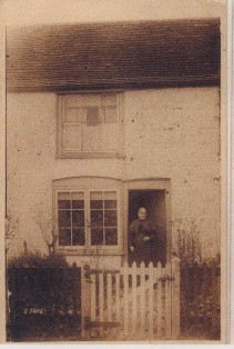 William's mother taken in the 1870's outside her home in Church Street, Henham.